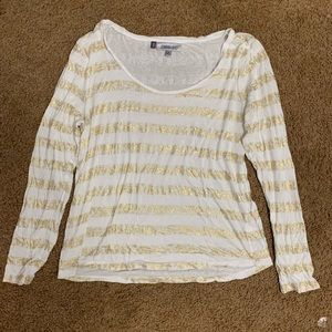 Gold and white striped Jeniffer Lopez top